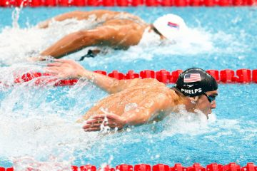 BEIJING - AUGUST 16:  (L-R) Milorad Cavic of Serbia and Michael Phelps of the United States compete in the Men's 100m Butterfly Final held at the National Aquatics Centre during Day 8 of the Beijing 2008 Olympic Games on August 16, 2008 in Beijing, China.  (Photo by Jamie Squire/Getty Images)